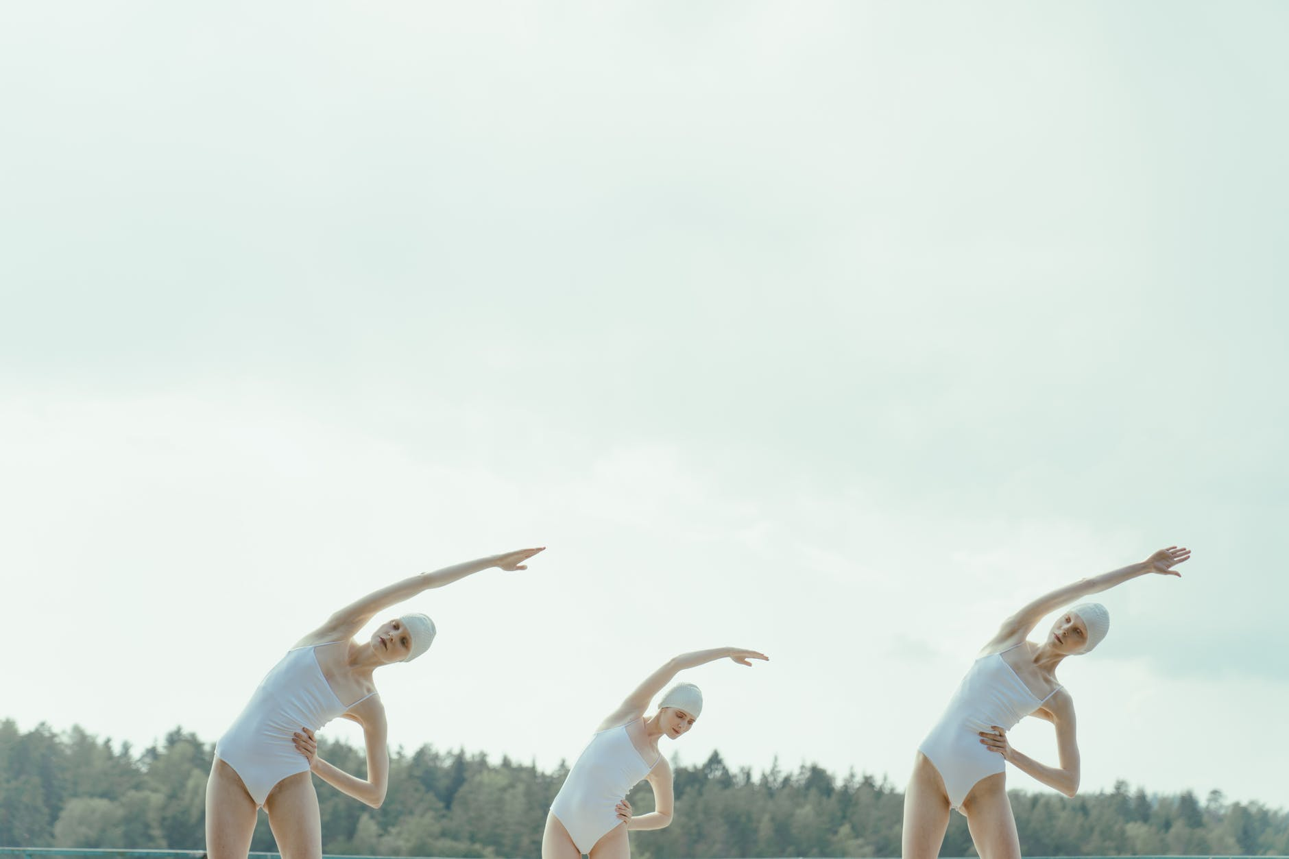 women in swimsuits stretching